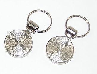 1 Schlüsselanhänger mit runder Scheibe 00.71//736