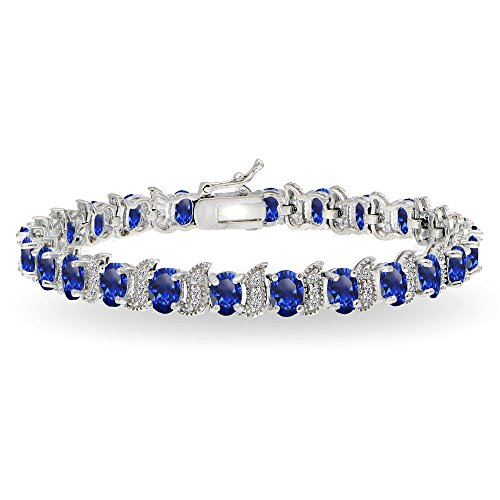 GemStar USA Sterling Silver Created Blue Sapphire 6x4mm Oval and S Tennis Bracelet with White Topaz Accents Blue Sapphire Topaz Bracelet
