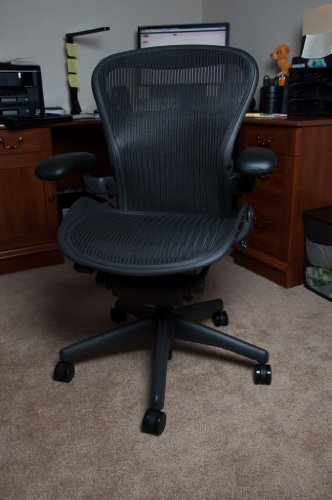 Herman Miller Aeron Chair Highly Adjustable with PostureFit Lumbar Support and Black Leather Arms - Medium Size (B) Graphite Dark Frame, Classic Dark Carbon Pellicle Mesh Home Office Desk Task Chair (Support Aeron Posturefit)