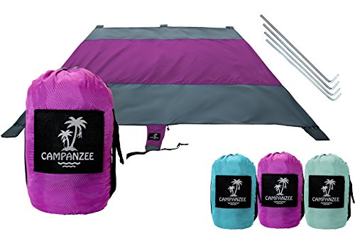Beach Blanket by Campanzee | Sand Free, Oversized 9 x 10 Ft, and Water Proof For Outdoor Use as a Camping, Festival, or Picnic Blanket | 5 Sand Pockets, Rip-Stop Nylon Fabric, and 4 Anchor Stakes