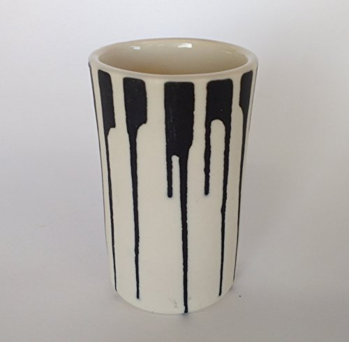 a pair of 3oz elegant, porcelain, shotglasses. (2 ()