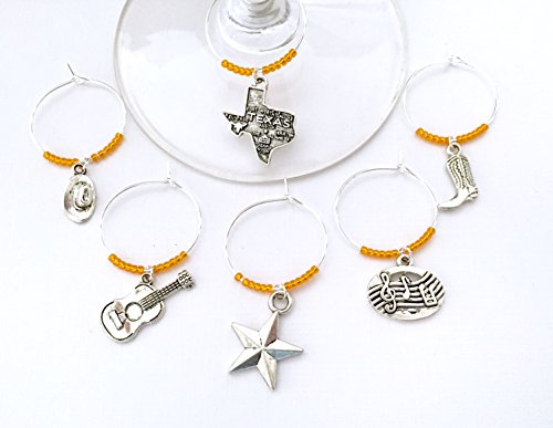 Austin Texas Wine Charms. Inspired by Austin Music and Country scene. Charms include Texas Charm, Guitar, Cowboy Hat, Cowboy Boots, Music Notes, and Texas Star. Set of 6. ORANGE BEADS.