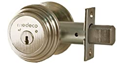 The Medeco® Maxum deadbolt exceeds Grade 1 ANSI/BHMA A156.36 standard for auxiliary locks. Solid brass, free turning collar and 1/4 inch diameter mounting bolts resist wrenching, prying and hammering attacks. One inch throw hardened steel bol...