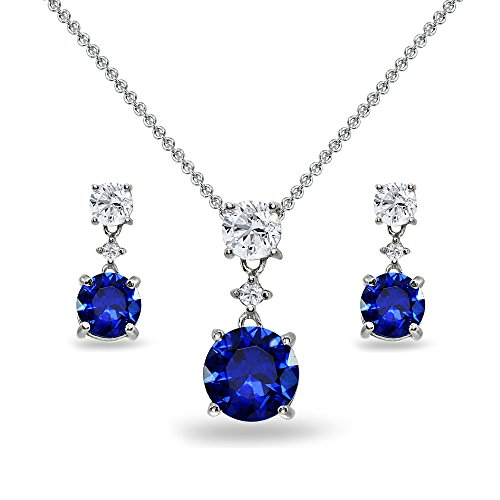 - Sterling Silver Created Blue Sapphire & White Topaz Round Three Stone Dangling Necklace & Stud Earrings Set