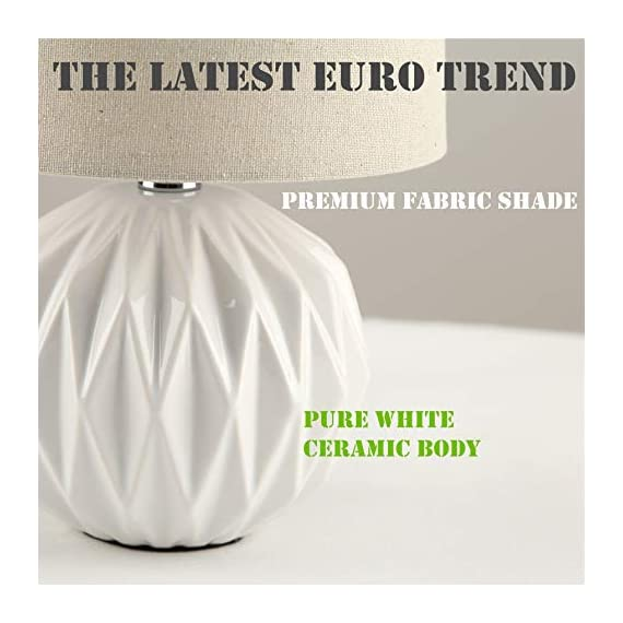 "Tayanuc Small Geometric Ceramic Bedside Nightstand Table Lamp, White Textured Desk Lamp Linen Drum Fabric Shade for Living Room Family Bedroom - Ceramic Table Lamp: This white ceramic table lamp shaped like a pineapple takes a fresh twist with textural geometric ceramic body. The solid color allows the plentiful texture and modern silhouette to truly shine and adds a hint of glam to nightstand. Excellent gifts for the coming Thanksgiving Day. Materials: The inimitable desk lamp will turn heads with its smooth textured curves balanced on a white ceramic base. It is paired with beige linen drum fabric shade that casts an ambient glow. Dimensions: 7.5"" D x 12.6"" H. - lamps, bedroom-decor, bedroom - 41Sm09RnaUL. SS570  -"