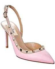 Color/material: pink leather. Design details: platinum-tone pyramid-studded trim. Adjustable ankle strap with buckle closure. Lightly padded leather insole. Smooth leather sole. 3.5in heel. Please note: All measurements are approximate and we...