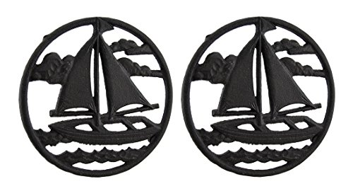 2 Piece Rustic Brown Sailboat On the Sea Round Cast Iron Trivet ()