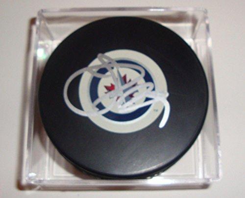 Johnny Oduya Signed Puck w/COA Winnipeg Jets Inaugural Autograph Souvenir 2011 A - Autographed NHL Pucks - Winnipeg Jets Signed