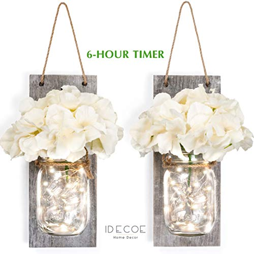 - iDECOE Premium Mason Jar Wall Decor Sconces - Rustic Grey Decorative Wall Decor with LED String Lights, 6 Hours Auto Timer, Wrought Iron Hooks, Silk Hydrangea Flower for Home Decoration (Set of 2)