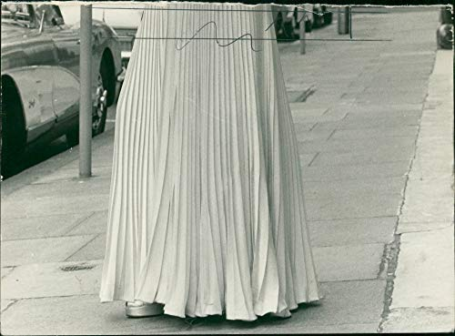 Vintage photo of Cream crepe satin evening dress trimmed with diamante yesterday.