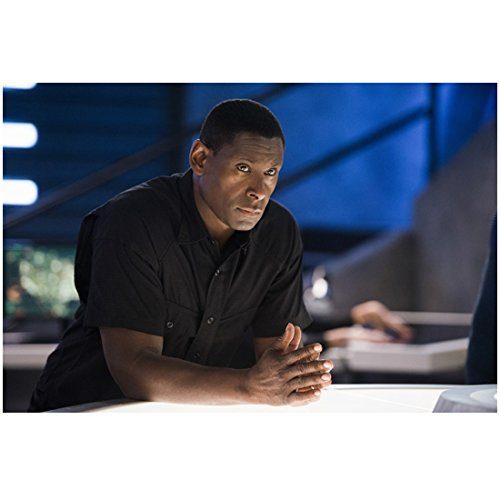 David Harewood 8 Inch PHOTOGRAPH Supergirl (TV Series 2015 - ) Palms Together Forearms Leaning on Table kn