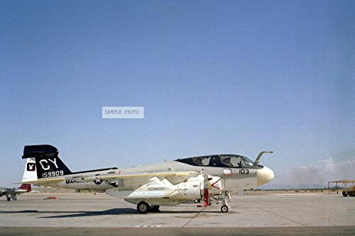 Photo A right side view of a Marine Electronic Warfare Squadron 2 (VMAQ-2) EA-6B Prowler aircraft parked on the flight line at Naval Air Station, Whiting Field, 01/01/1982