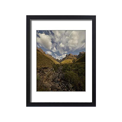 Media Storehouse Framed 24x18 Print of Clouds Fill The Sky Above a Range of Mountains Creating The (18246693)