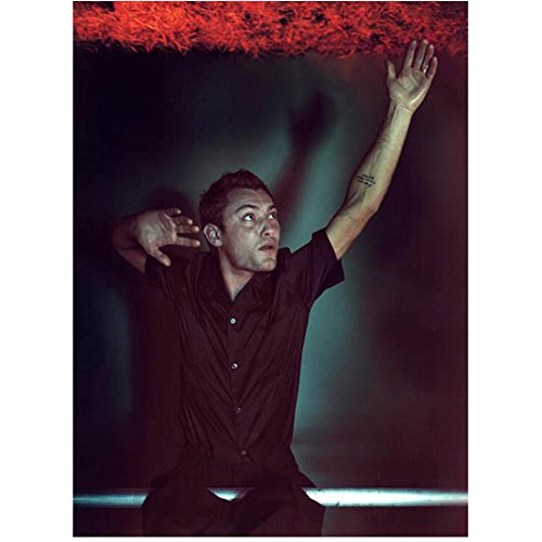 (Jude Law Seated with Hand Stretched Looking Up 8 x 10 Inch Photo)