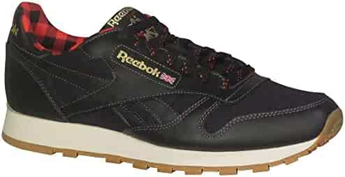 09c4a5e3aabb05 Reebok Men s CL Leather LJ Fashion Sneakers Black Primal Red Gold Paper  White