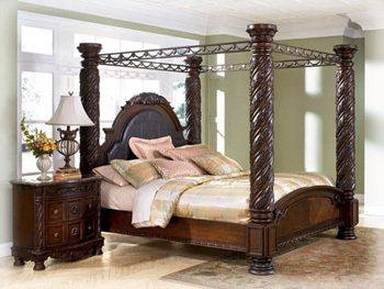 Ashley North Shore King Canopy Bed in Dark Wood