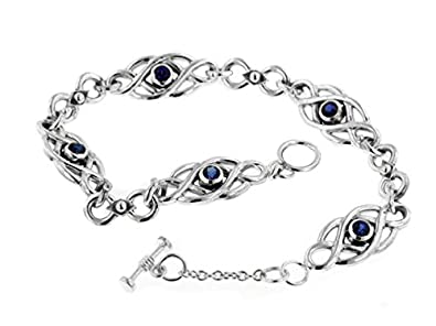 fc7692f082 Image Unavailable. Image not available for. Color: Sterling Silver Dark  Blue Sapphire Celtic Knot Bracelet ...