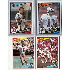 This Is the 1984 Topps Football Complete Near Mint 396 Card Set. Featuring Rookie Cards of Hall of Famers Dan Marino, John Elway, Howie Long, Eric Dickerson and Others. Loads of Stars Including Joe Montana, Lawrence Taylor, Marcus Allen, Terry Bradshaw, Art Monk, Ronnie Lott, Walter Payton, Darrell Green and Others!