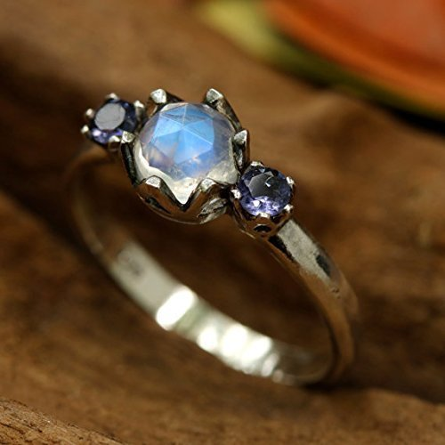 - Round faceted moonstone ring with iolite side set gems in prongs setting with sterling silver band