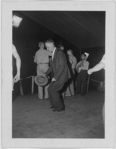 1938 Photo Fiddling Bill Hensley, dancing in foreground at the Mountain Music Festival, Asheville, North Carolina Location: Asheville, North - In North Shopping Asheville Carolina