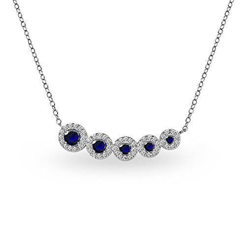 (GemStar USA Sterling Silver Created Blue Sapphire Graduated Journey Necklace with White Topaz Accents)