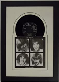 45rpm 6 78 inch vinyl record and record sleeve frame featuring white mat