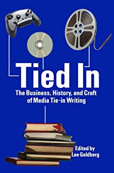 Tied In: The Business, History and Craft of Media Tie-In Writing by [Collins, Max, Barer, Burl, Goldberg, Tod, Massie, Elizabeth , Mariotte, Jeff, Benson, Raymond, Rabkin, William , Cox, Greg, Holder, Nancy]