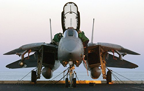 Home Comforts an F-14 Tomcat assigned to The Pukin Dogs Fighter Squadron One Four Three (VF-143) receives - Wall F-14 Tomcat