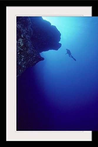 GreatBIGCanvas ''Hawaii, Maui, Molokini, Diver in Distance Alongside Black Wall'' by Dave Fleetham Photographic Print with Black Frame, 24'' x 36'' by greatBIGcanvas