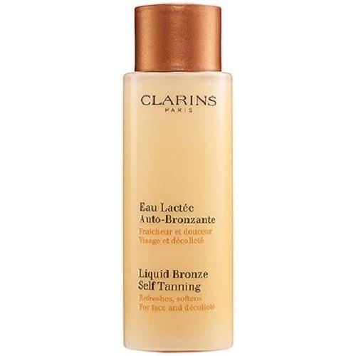 Clarins LIQUID BRONZE Self Tanning 4.2 oz for face and decollete 125 ml NIB