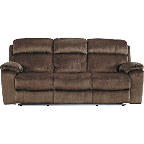 Ashley Uhland 6480315 88.6″ Power Reclining Sofa with Adjustable Headrest Split Back Cushion Piped Stitching Pillow Top Arms and Fabric Upholstery in Chocolate