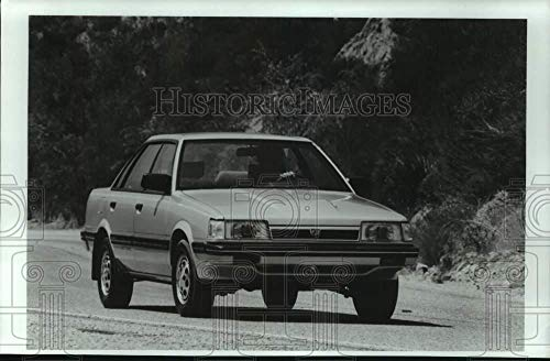 (Vintage Photos 1986 Press Photo Subaru RX 4WD Turbo Sedan Parked on Road - mjt19544)
