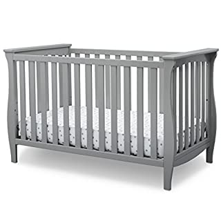 Take the first step towards creating the nursery of your dreams with the Lancaster 3-in-1 Convertible Crib from Delta Children. Its sleigh-style silhouette and swooping apron on both ends gives this timeless baby crib an elegant touch. Designed to gr...