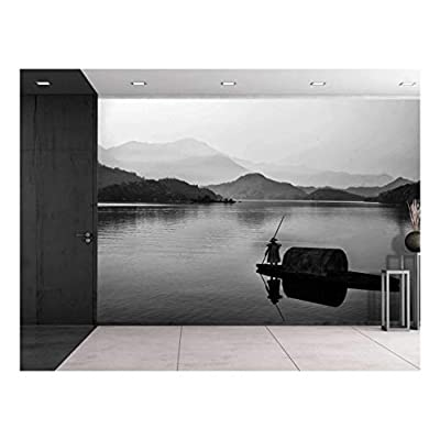 Black and White Canoe with a Man Rowing Down a Lake Towards The Mountains Wall Mural, That's 100% USA Made, Delightful Technique