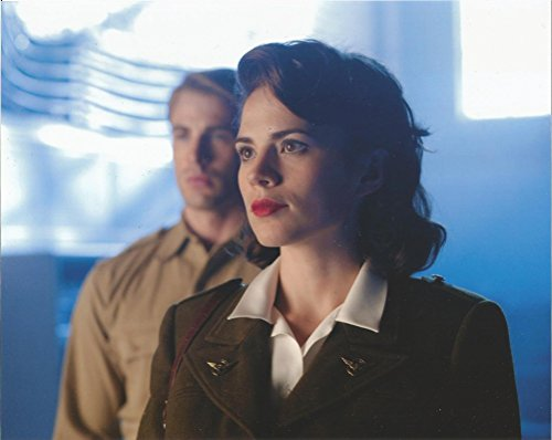 Captain America Hayley Atwell in military uniform close up with Chris Evans behind her 8 x 10 inches Movie Photo