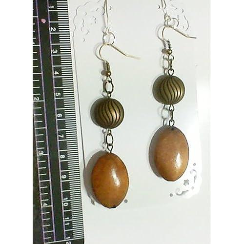 1 Paire de boucles d'oreilles bois et couleur bronze.Accessoires. Couleur bronze.