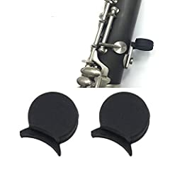 Eliminate sore thumbs,provides extra thumb rest and protects your instrument and hands. Soft and durable,helps to maintain the correct finger position. It is suitable for most Clarinet. Stable Comfortable and Soft. Material: Rubber Color: Bla...