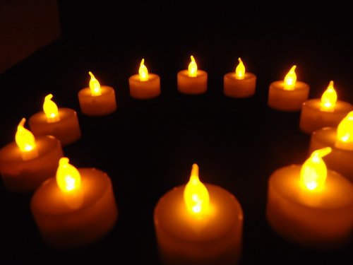 many candles arranged in a circle