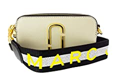We can't get enough of the Marc Jacobs Snapshot collection. Small enough to stay tucked out of the way, and roomy enough for essentials, this Marc Jacobs crossbody bag is sporty and fun with glittery trim and a woven strap.