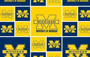 UNIVERSITY OF MICHIGAN COTTON FABRIC-100% COTTON MICHIGAN WOLVERINES COTTON FABRIC SOLD BY THE ()