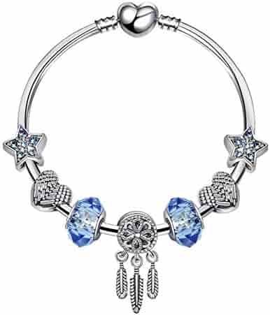 DiamondJewelryNY Double Loop Bangle Bracelet with a St Andrew Kim Taegon Charm.