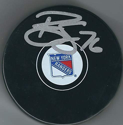 Autographed Brady Skjei New York Rangers Hockey Puck with ()