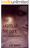 She Lights Up the Dark (November Snow Book 2)