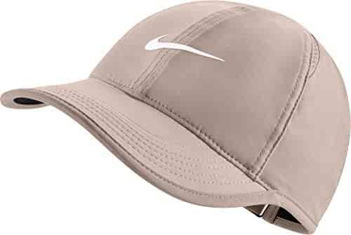 buy online 2011c da69a NIKE Women s Feather Light Adjustable Hat