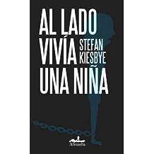 Al lado vivia una nina / Next door lived a girl (Spanish Edition)