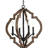 The statement-making four-light Spicewood pendant features a rich, solid wood surrounded in a classic quatrefoil pattern. Wrought iron metal fittings in a Gilded Iron finish are paired with a distressed pine frame to complement Rustic and reclaimed d...