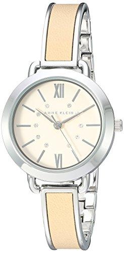 Anne Klein Women's AK/2437TNSV Swarovski Crystal Accented Silver-Tone and Tan Bangle Watch