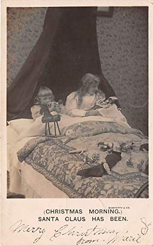 People and Children Photographed on Postcard, Old Vintage Antique Post Card Christmas Morning Santa Claus has been 1906