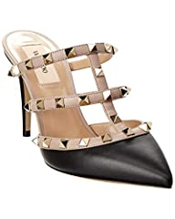 Please note: Size selections are European. For US conversions please reference size chart.. Made in Italy. Color/material: black and tan leather. Design details: gold-tone rockstud embellishment. Lightly padded leather insole. Smooth leather ...