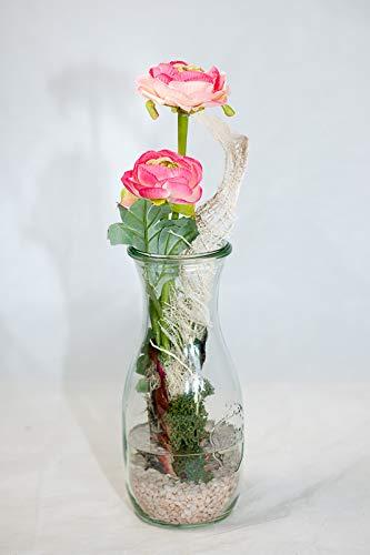 Centro de mesa con ranúnculo rosado en un florero-arreglo floral ...